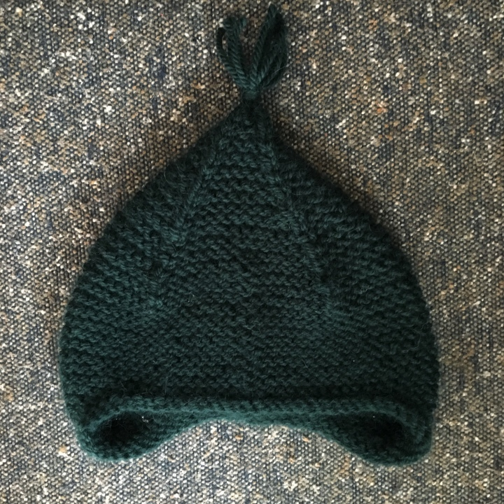 166e206c440 A pointy elfin hat on babies is nearly too much to handle. I knew I needed  to make this hat for a nephew. The pattern is a free one from Purl Soho.